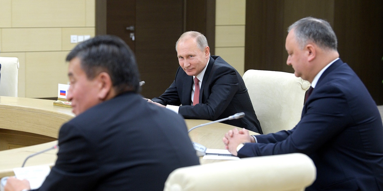Russia's President Vladimir Putin (center) and Kyrgyzstan's President Sooronbay Jeenbekov (left) at an informal meeting of the heads of the Commonwealth of Independent States in December 2017. Kyrgyzstan is the #1 recipient of Russian foreign aid. Photo by the Office of the President of Russia, licensed under (CC by 4.0).