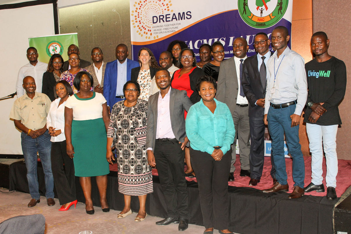 NAC staff, the JSI South Africa team, and AidData's Emilie Efronson pose for a photo at the launch of the updated NACMIS system in Lusaka