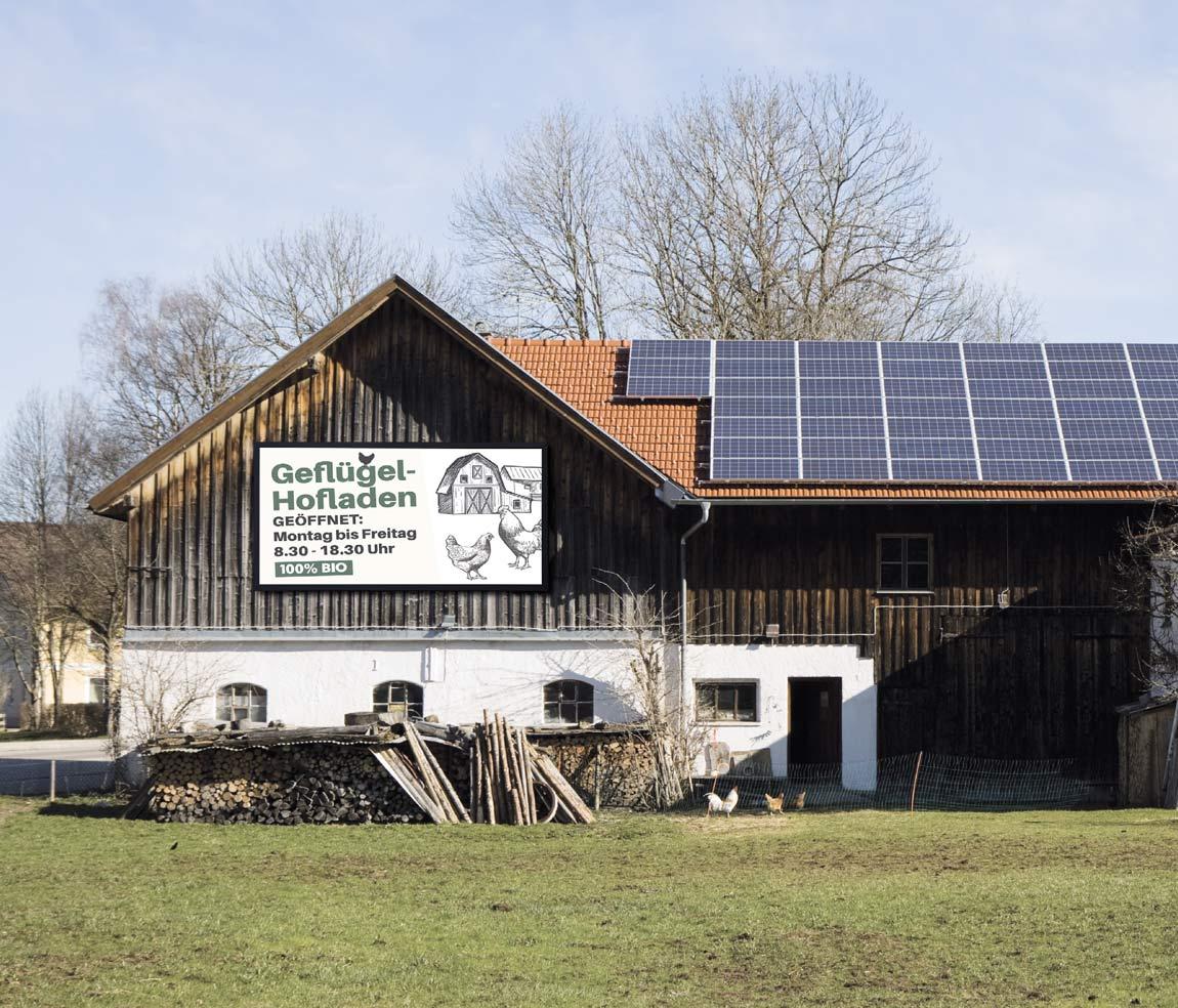 LED-Wand an einem Bauernhaus Bauernhof