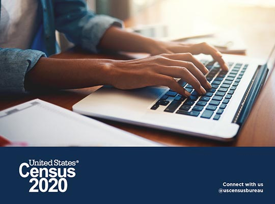 Person typing on computer Census 2020 logo below