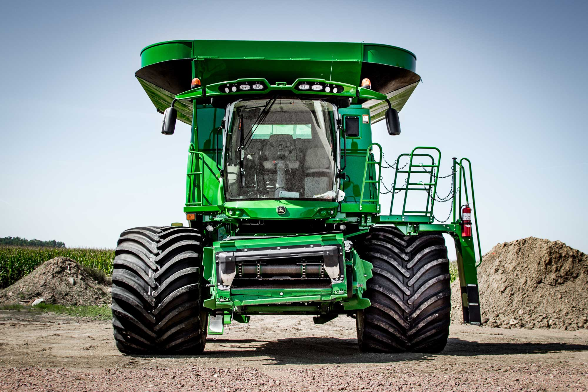 A John Deere combine with Goodyear LSW 1400/30R46 super single tires.