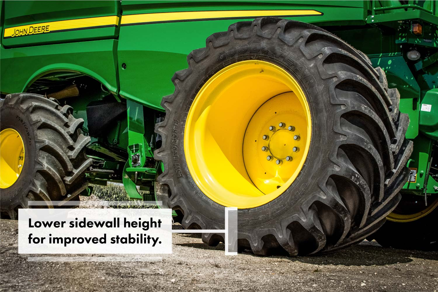 A John Deere combine with Goodyear LSW1400/30R46 super single tires.