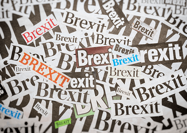 "A group of small, overlapping newspaper clippings which all say ""Brexit""."