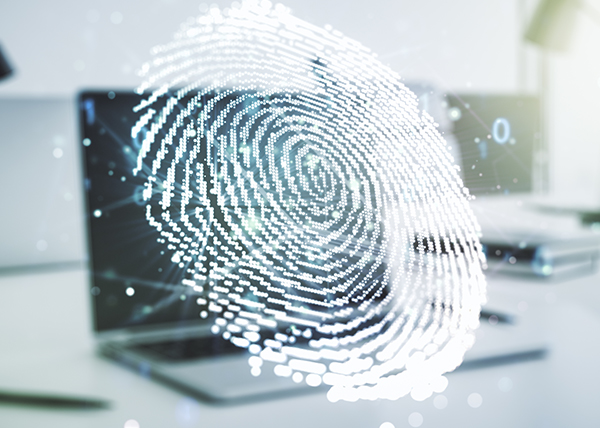 A pixelated fingerprint overlaid on a blurred laptop.