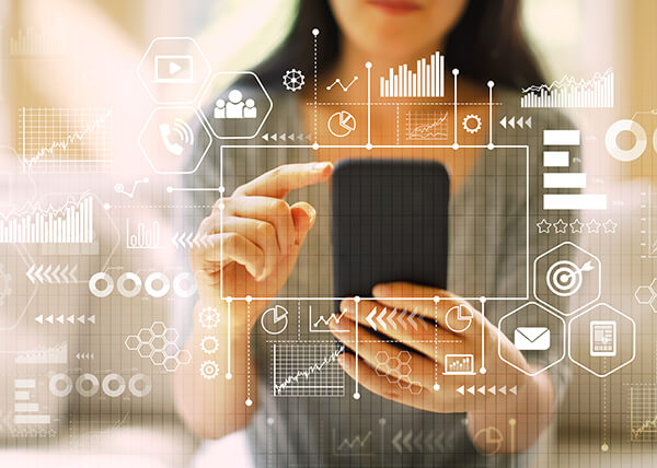 Woman holding a smartphone. There is an overlay of various circles, charts, and icons, representing a workflow.