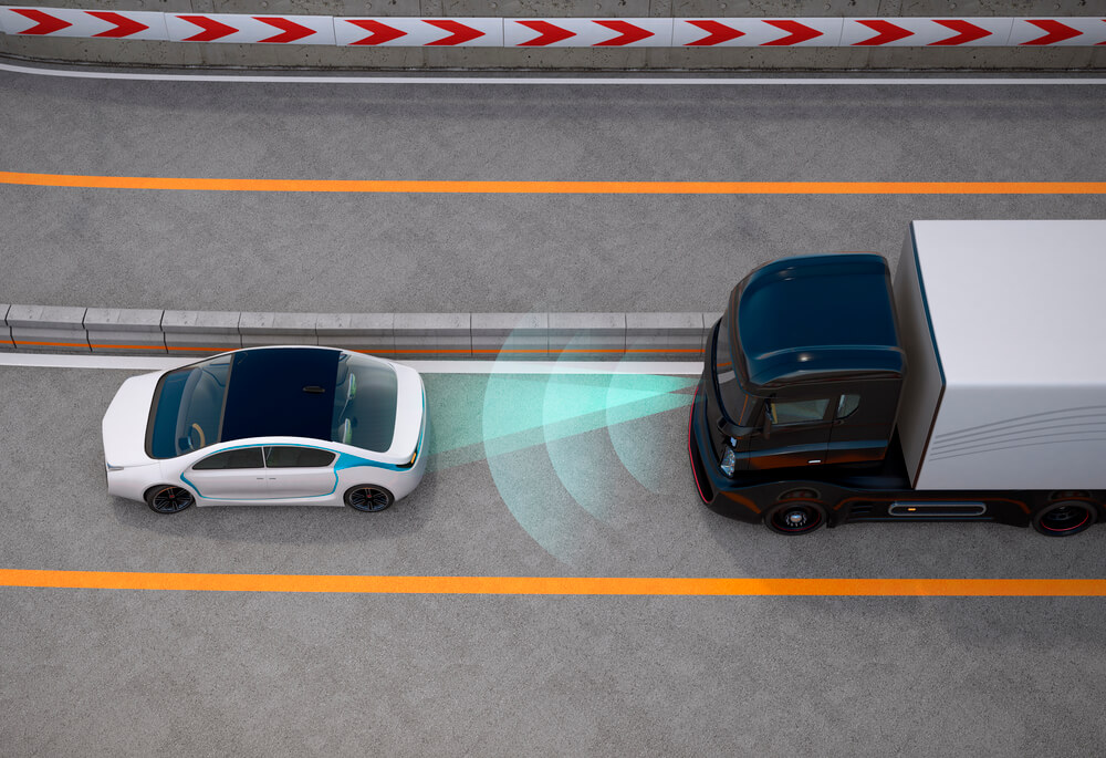 Photo of a truck using ADAS (advanced driver assistance systems) to avoid collitions