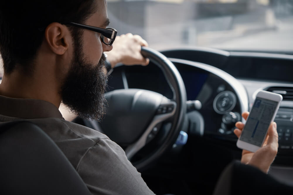 Photo of a driver using mobile phone while driving