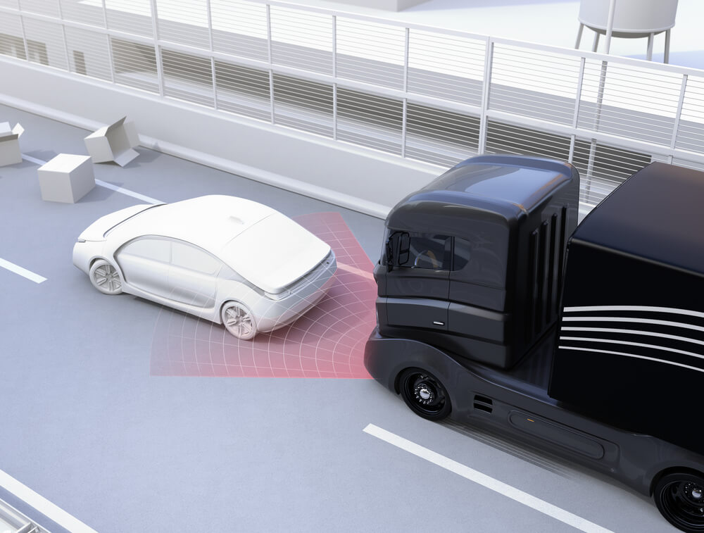 Photo of a truck avoiding an accident using a collision avoidance system