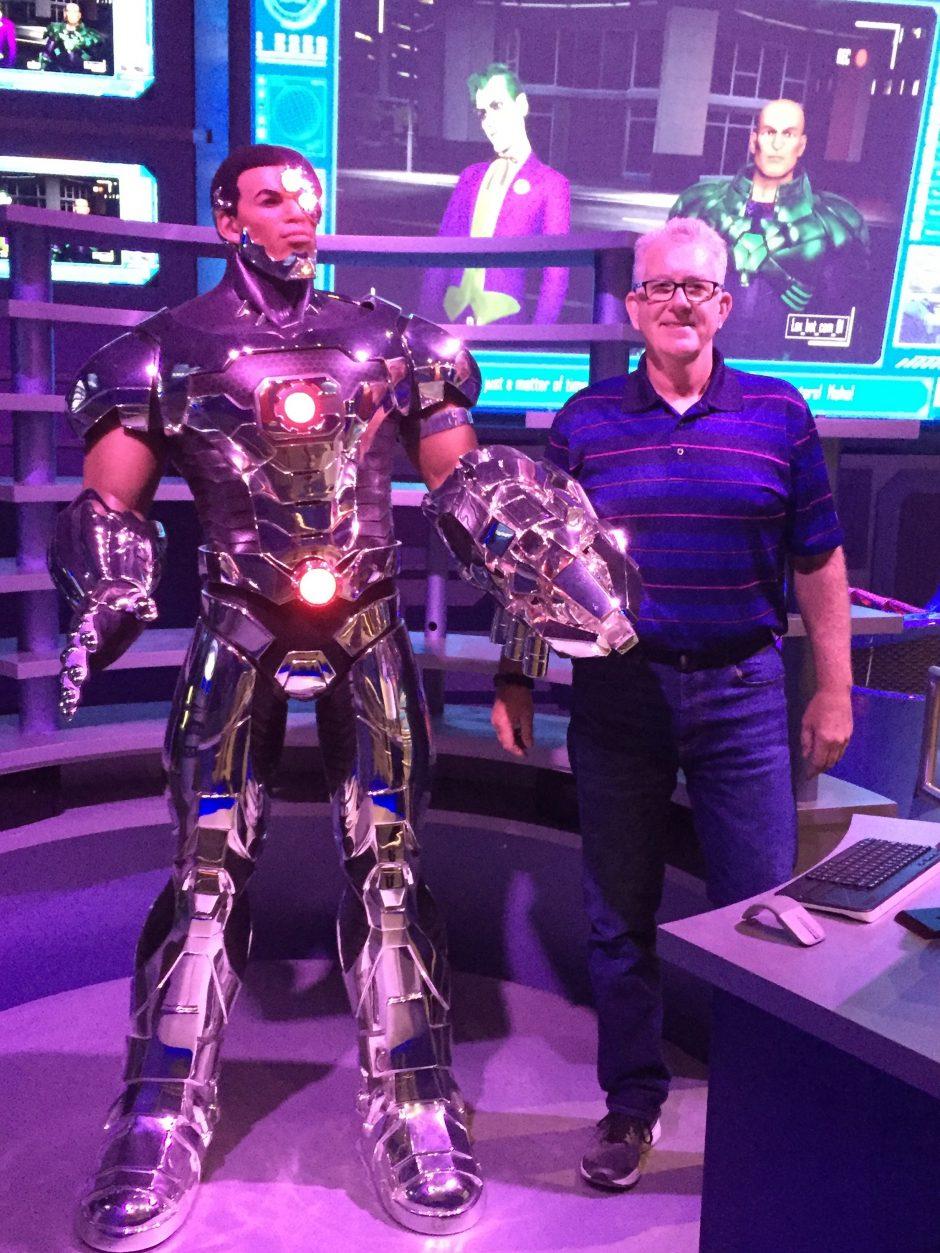 John Salisbury standing with his 5th Cyborg creation.