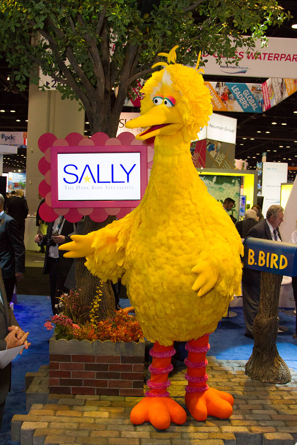 "Big Bird flew to IAE '18 to let everyone know, ""there's a mystery happening on Sesame Street!""."