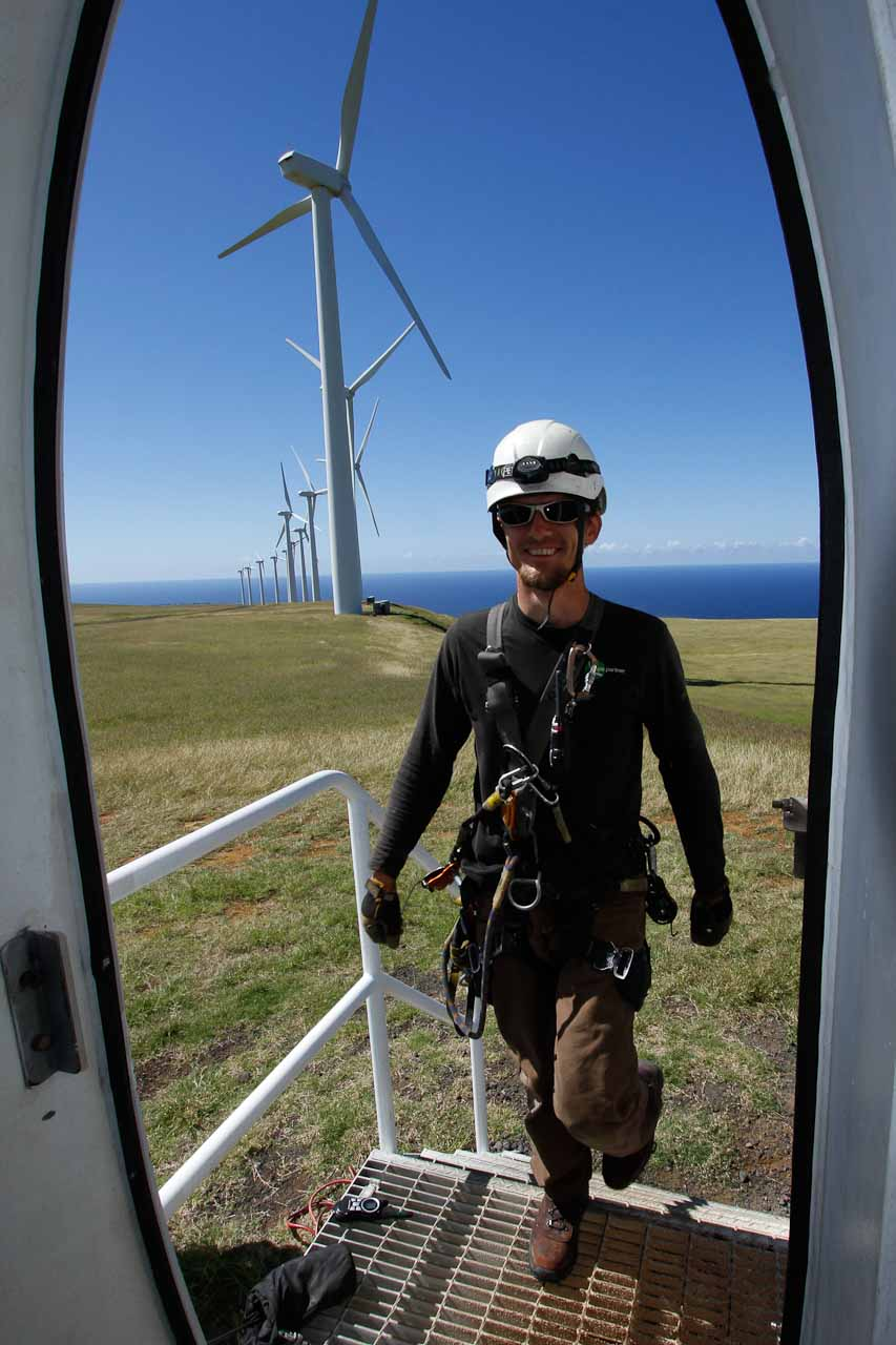 Technician Standing at Entrance Door to Wind Turbine