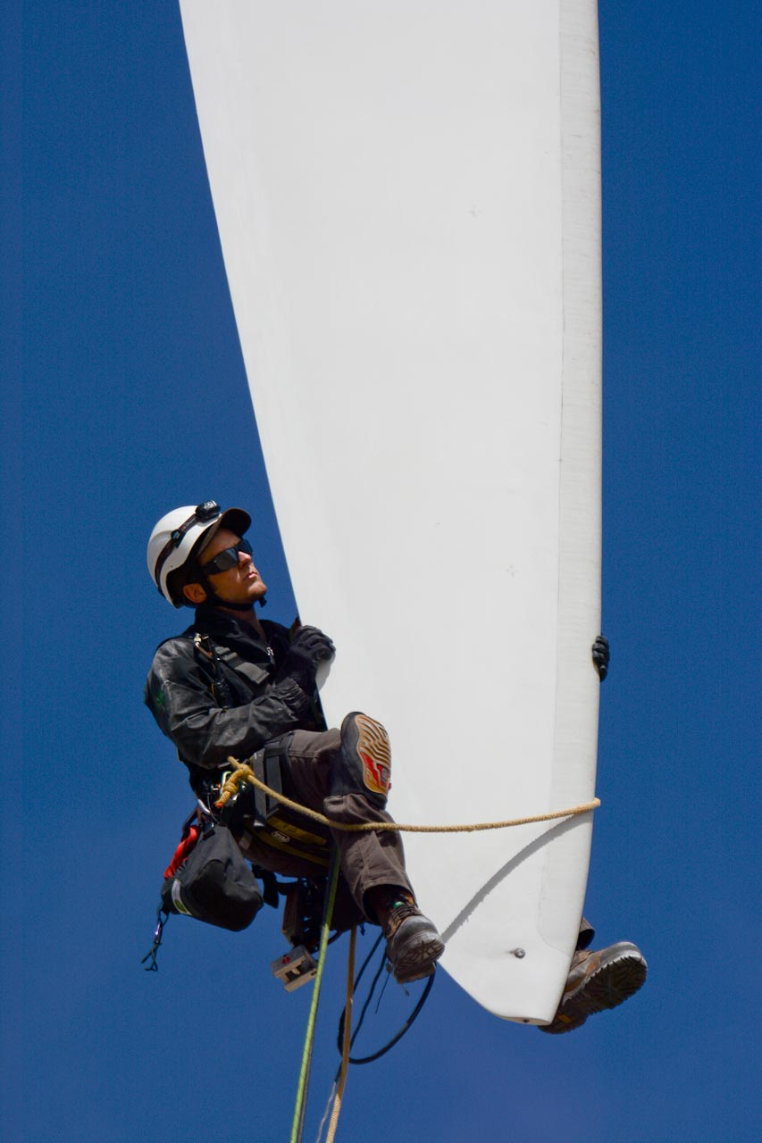 Rope Access Technician Inspecting Blade Trailing Edge