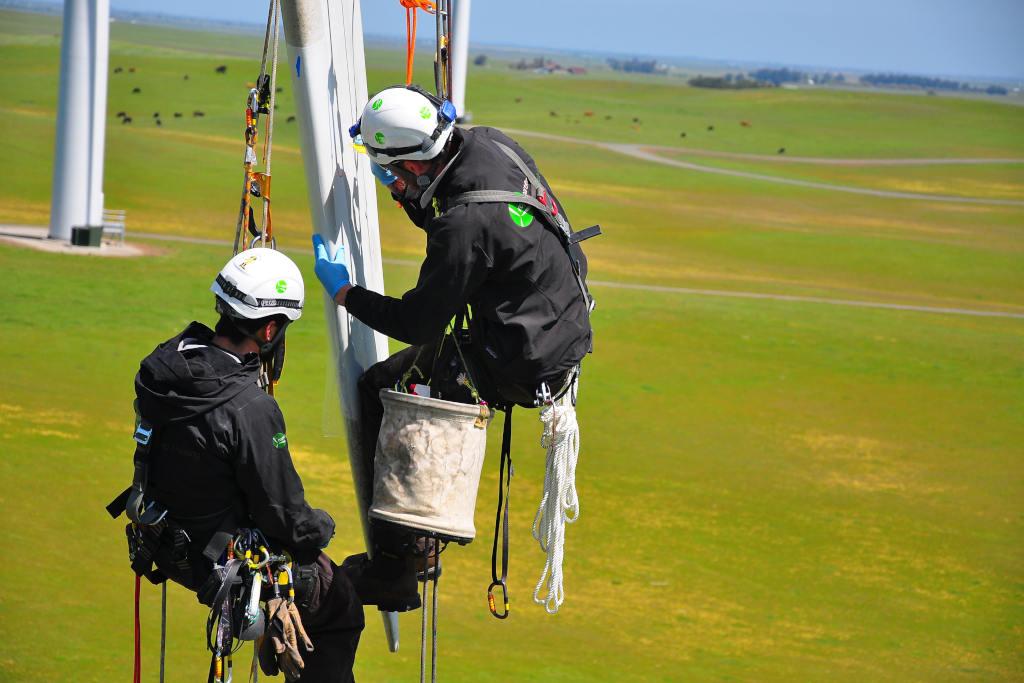 Fiberglass blade repair by two WindCorps technicians