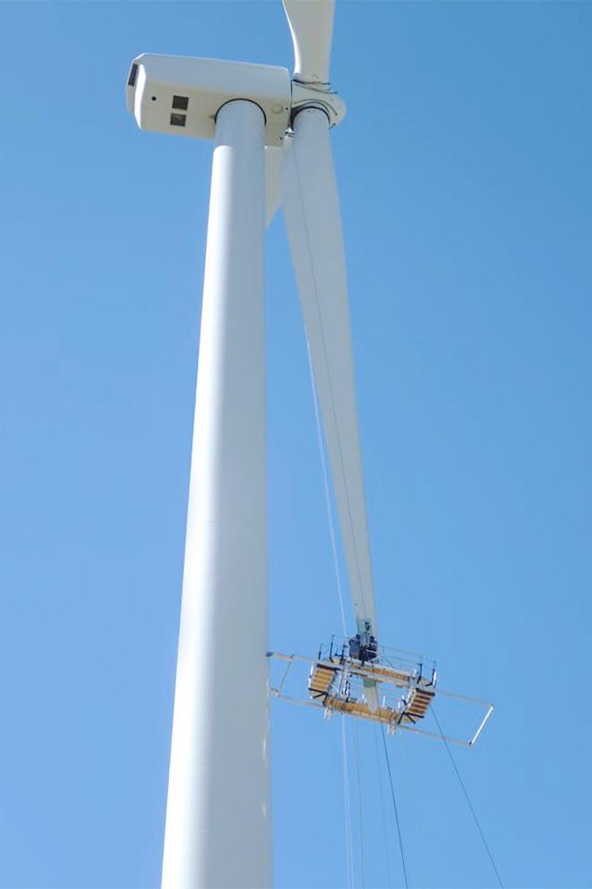 WindCorps Technicians Repairing Wind Turbine Blade