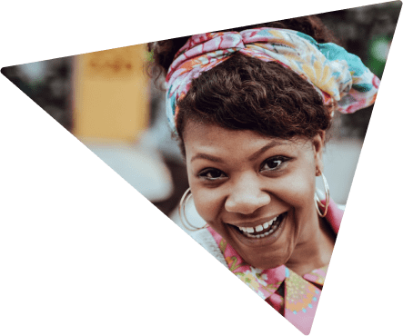 A woman with big earings smiling