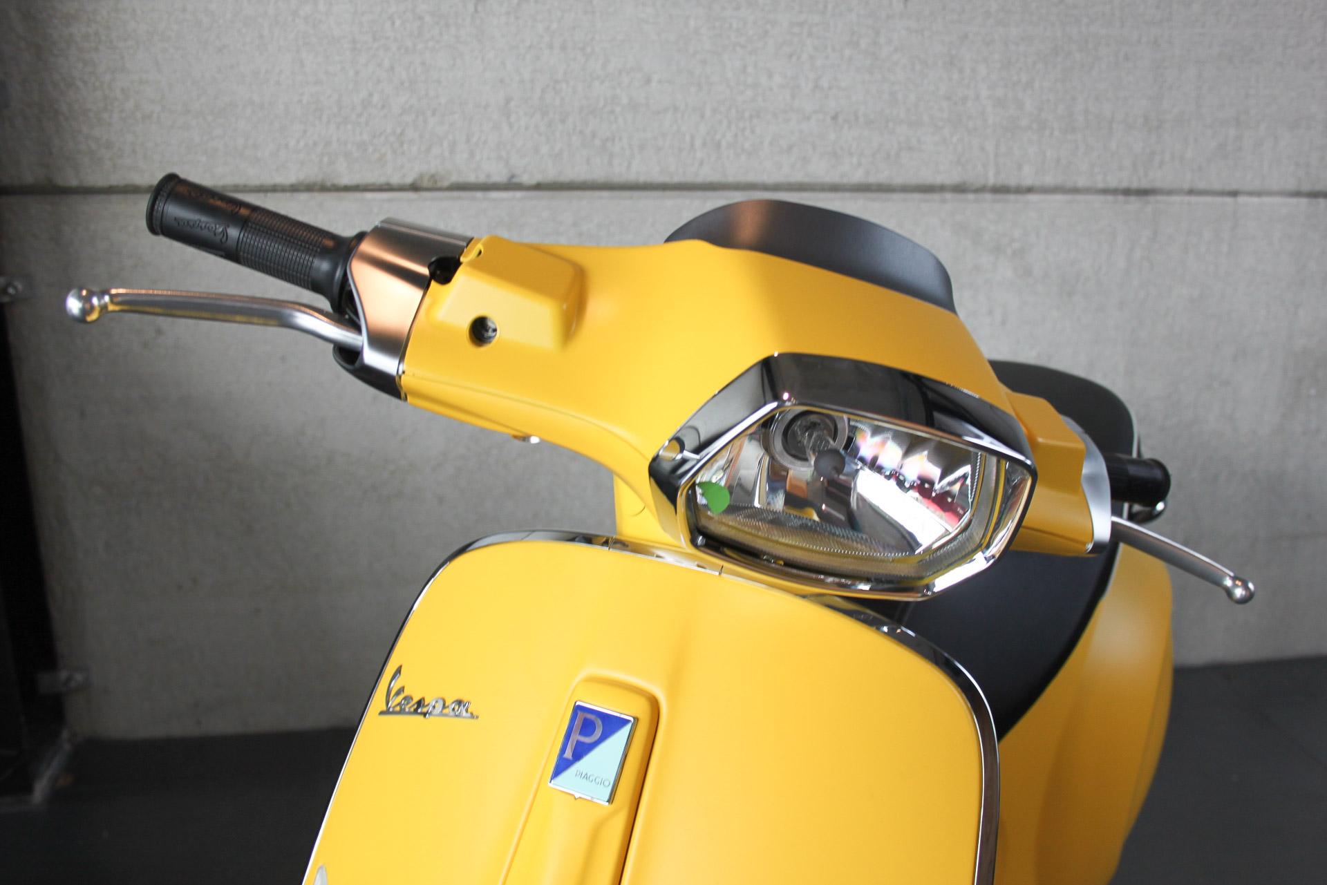 Vespa geel Koplamp