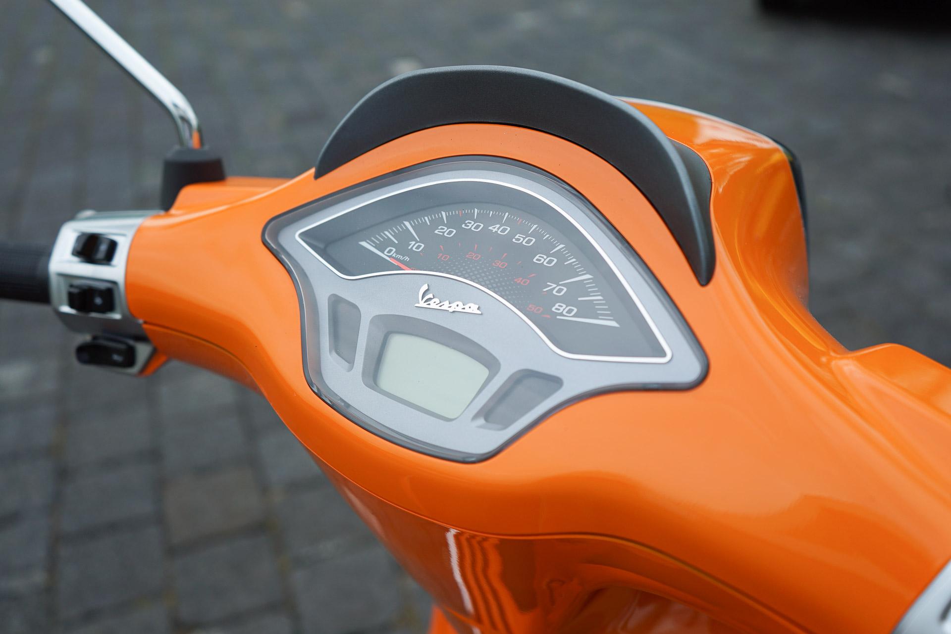 Vespa oranje Kilometerteller
