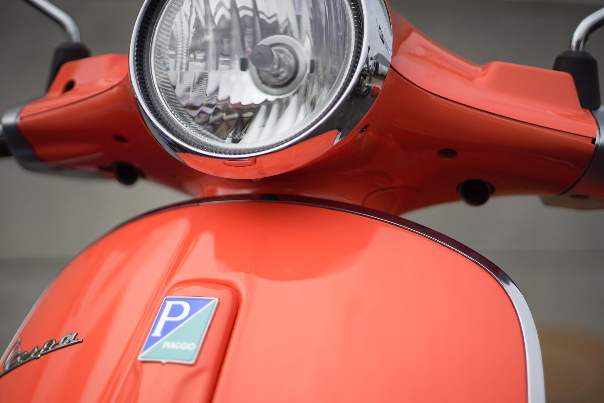 Vespa oranje Koplamp