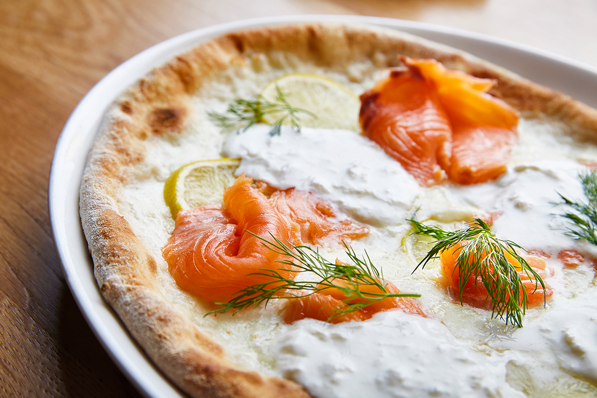Pizza with Smoked Mozzarella di Bufala, Stracciatella from Puglia, Smoked Wild Salmon, Lemon and Dill