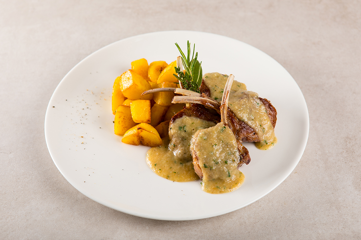 Rack of Lamb on a Anchovies Bread Sauce served with Roasted Potatoes
