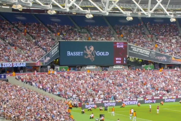 Olympic Stadium in Stratford. main screens and LED boards with basset and gold logo