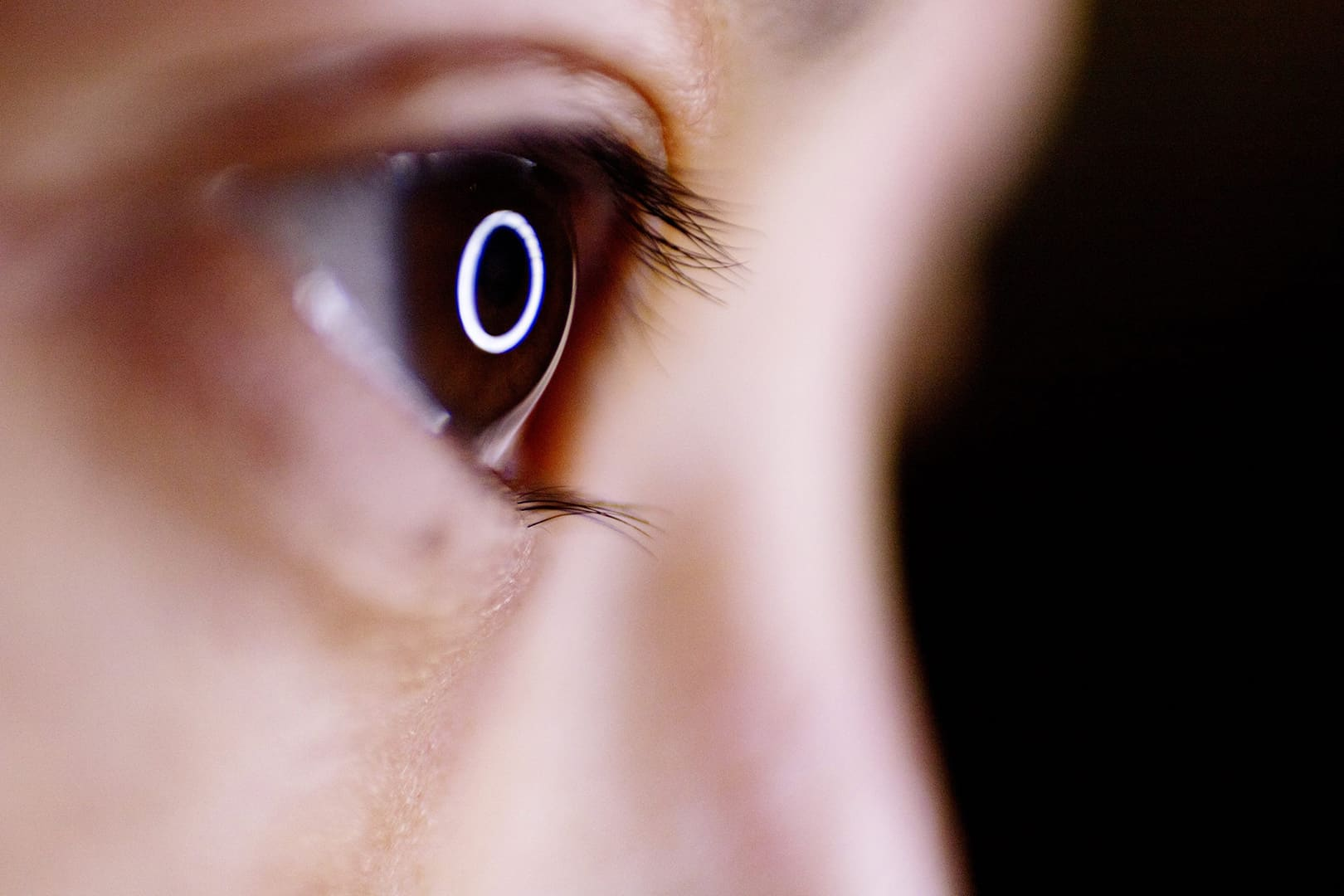 Close up of child eye with circle of light reflection and dark background stock photograph by Karl Tang EyeEm