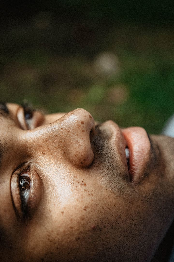 Close up portrait of a young mans face stock photograph by Gaile EyeEm