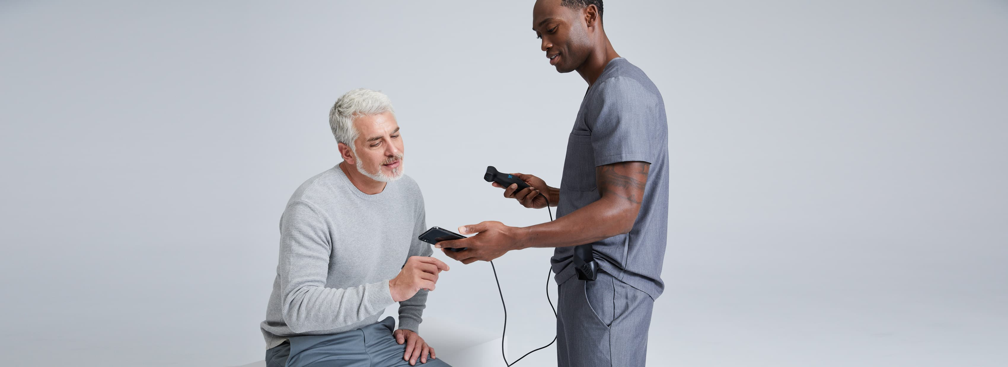 A doctor showing an ultrasound image to a man