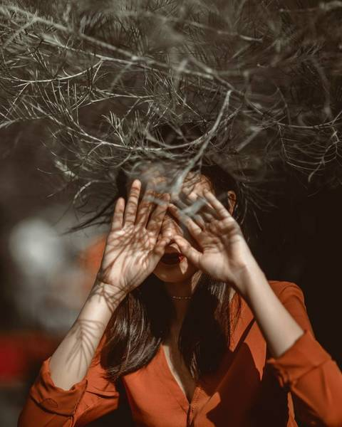 CLOSE-UP OF WOMAN WITH HANDS ON FACE