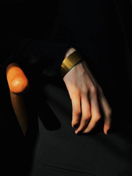 Cropped Hand Of Woman Against Black Background