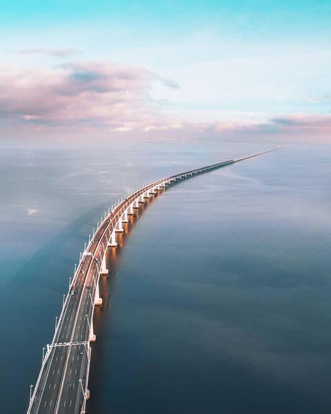 Aerial View Of Bridge Over Sea Against Sky