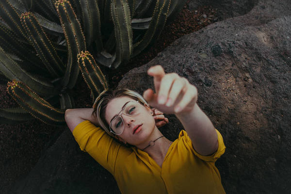 High Angle View Of Young Woman lying on rock