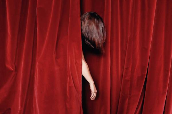 Cropped Image Of Woman Amidst Stage Curtain