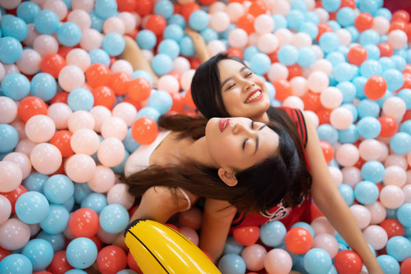 Female Friends At Ball Pool
