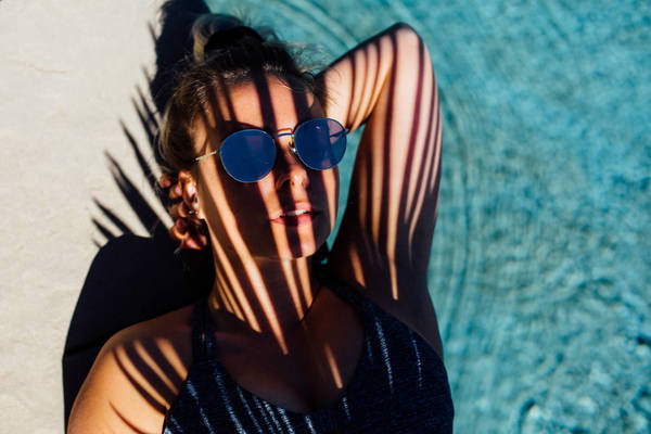 HIGH ANGLE VIEW OF WOMAN WEARING SUNGLASSES