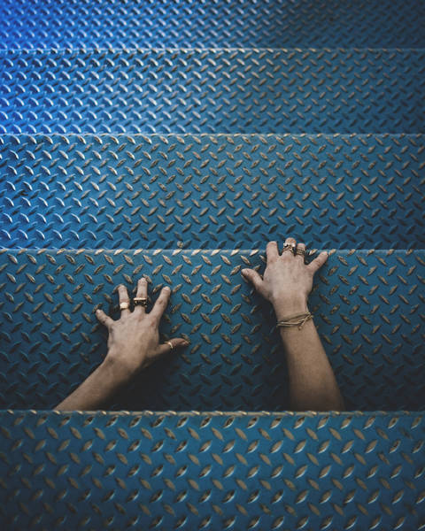 Cropped Hands Of Person On Metallic Steps