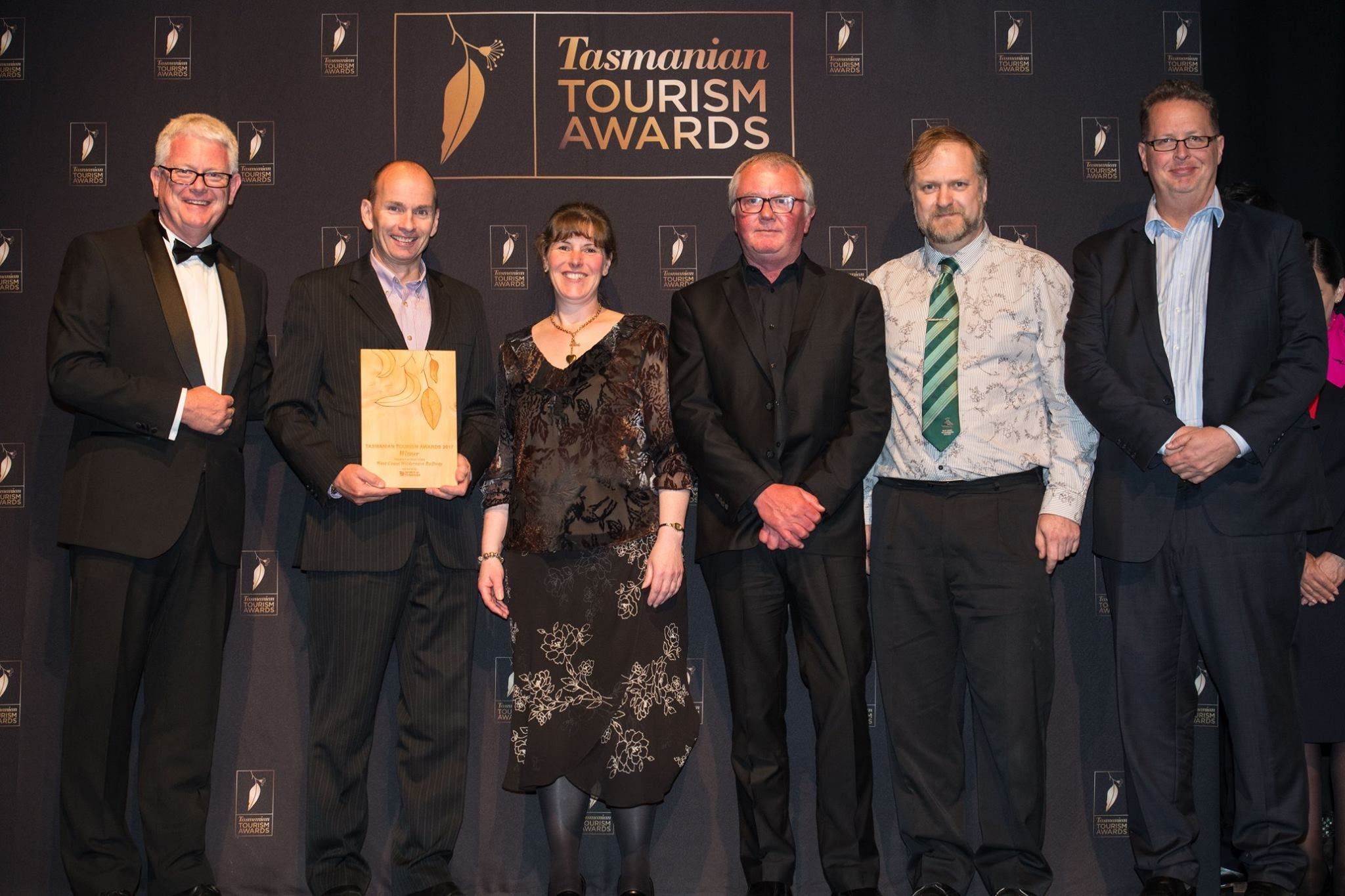 Proud West Coast Wilderness Railway team on stage at the 2017 Tasmanian Tourism Awards