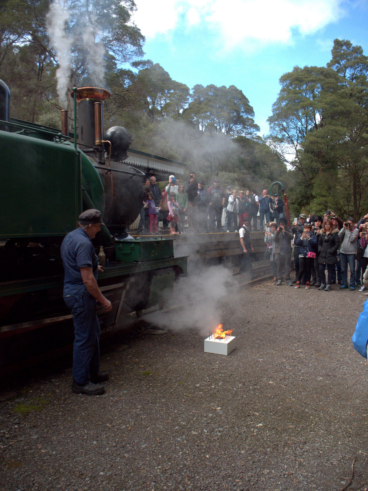 West Coast Wilderness Railway Loco No.1 'blows out' her birthday candles in front of an admiring group of passengers at Rinadeena Station