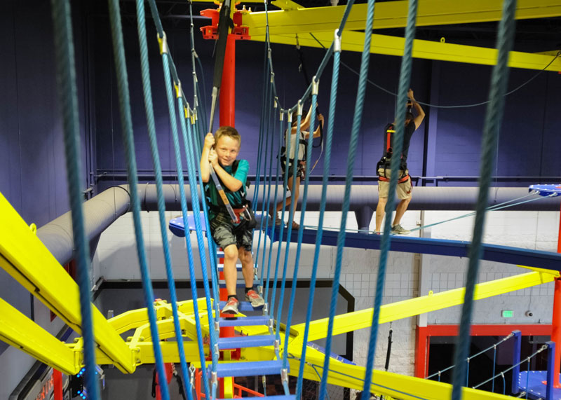 Young boy on an indoor ropes course