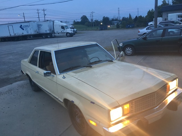 front view of eric the car guy's turbo fairmont with its headlights on