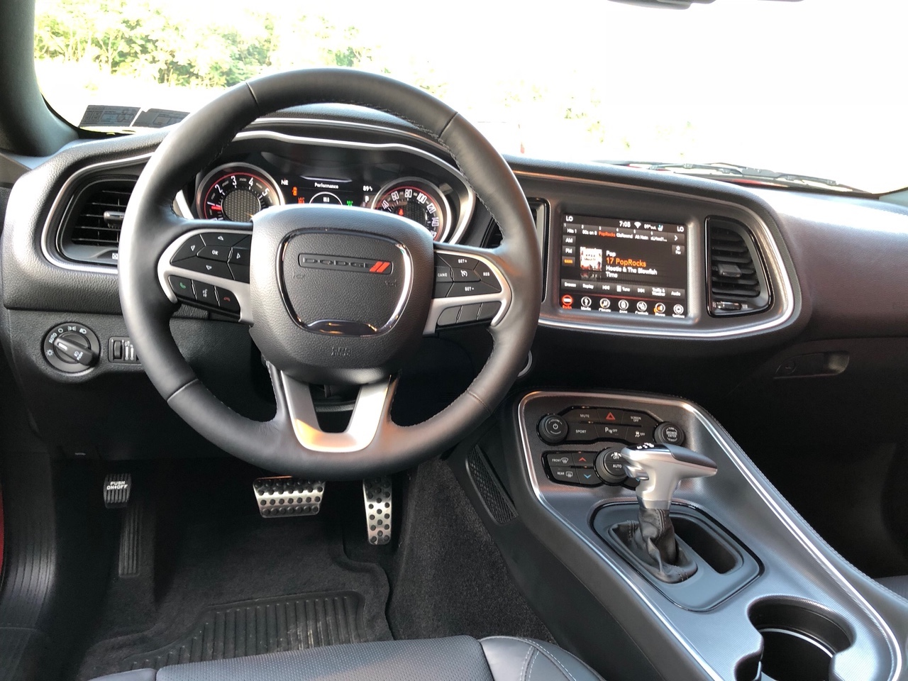 a photograph showing the steering wheel and dash of steve brice's 2018 dodge challenger