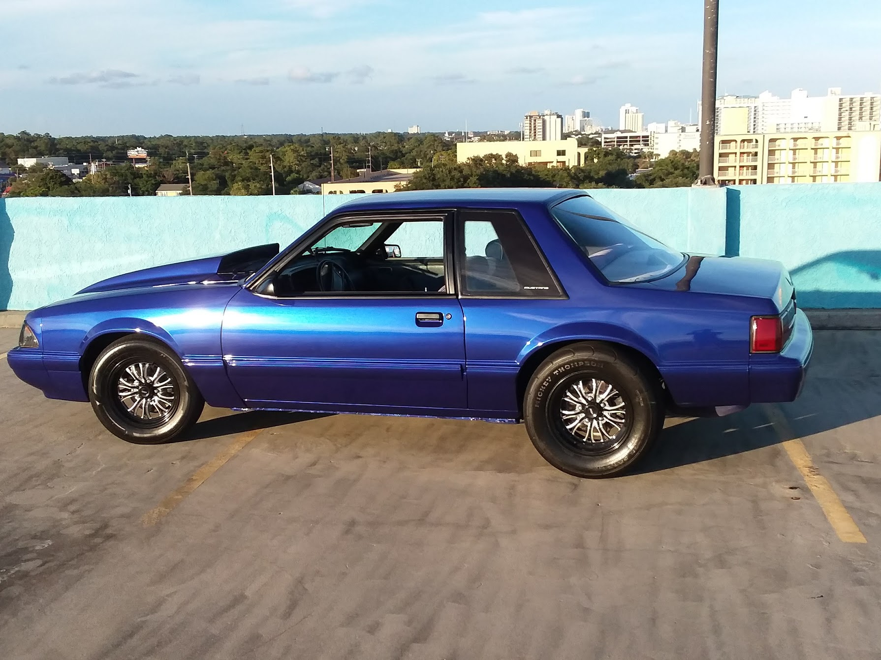 1987 blue ford mustang side view
