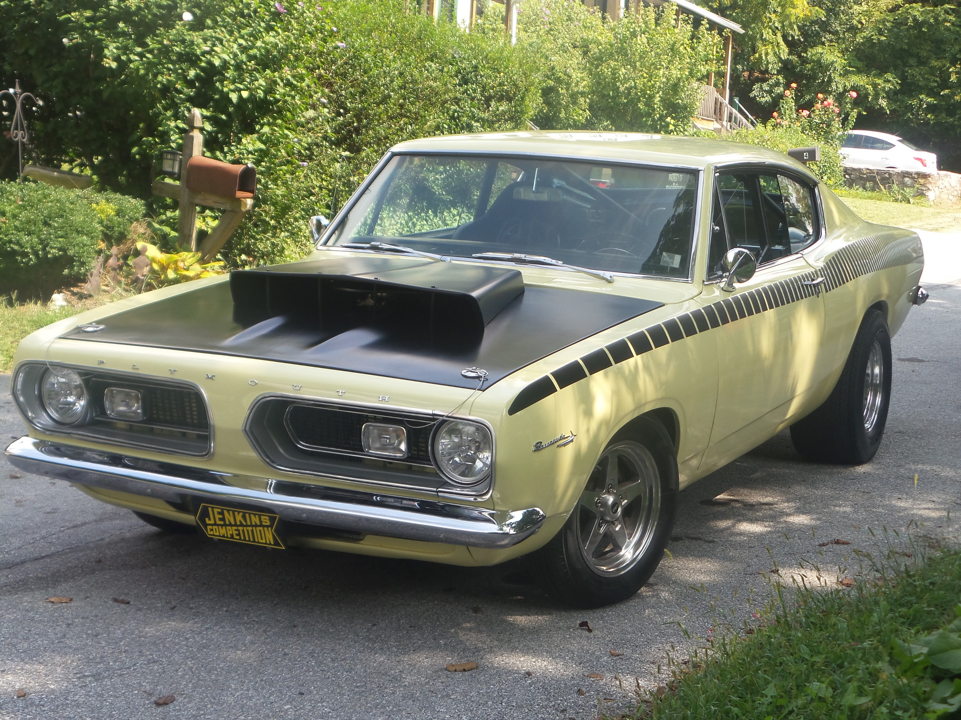 black and yellow 1967 plymouth barracuda