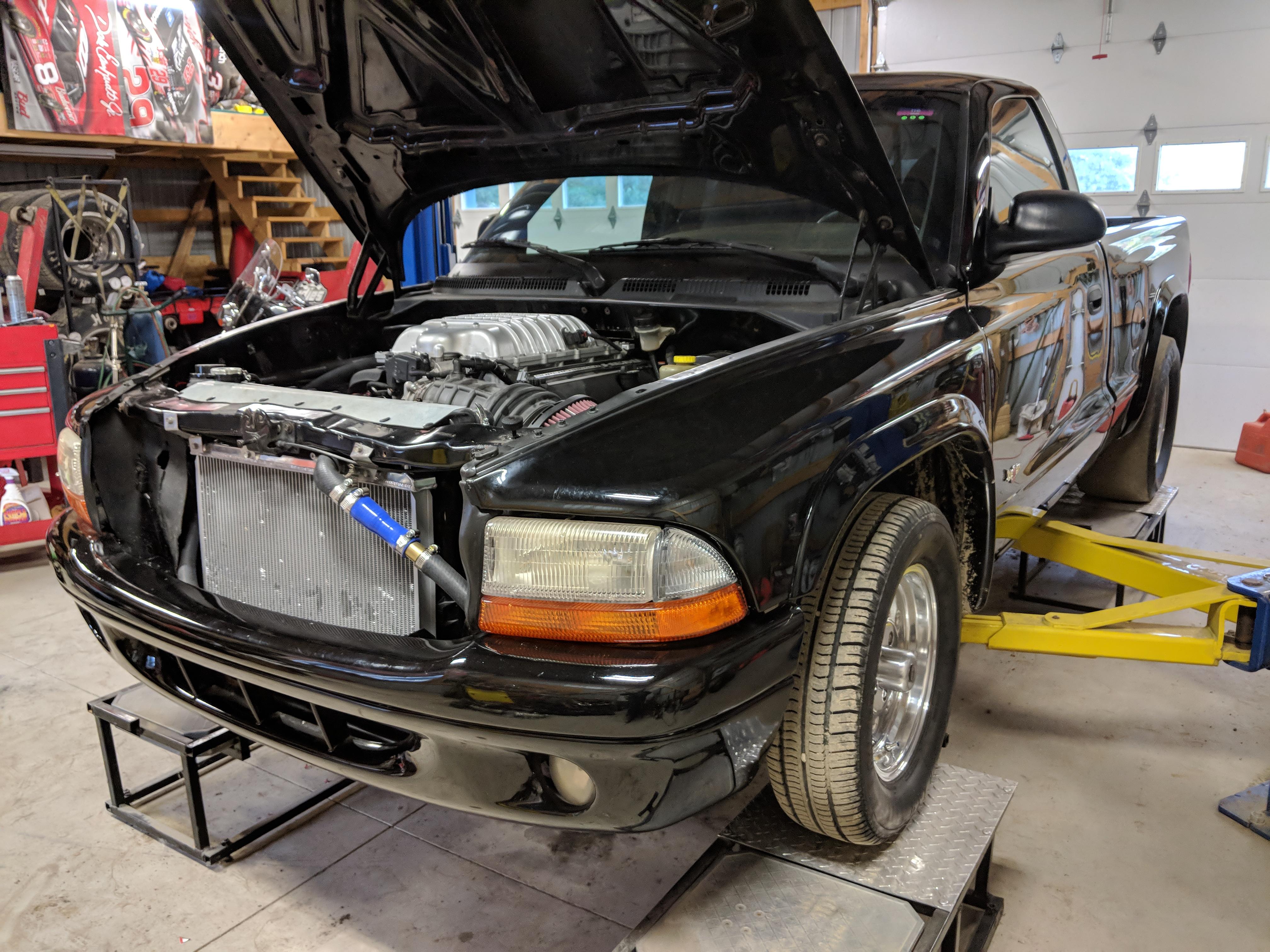 black 1998 Dodge Dakota with the hood popped