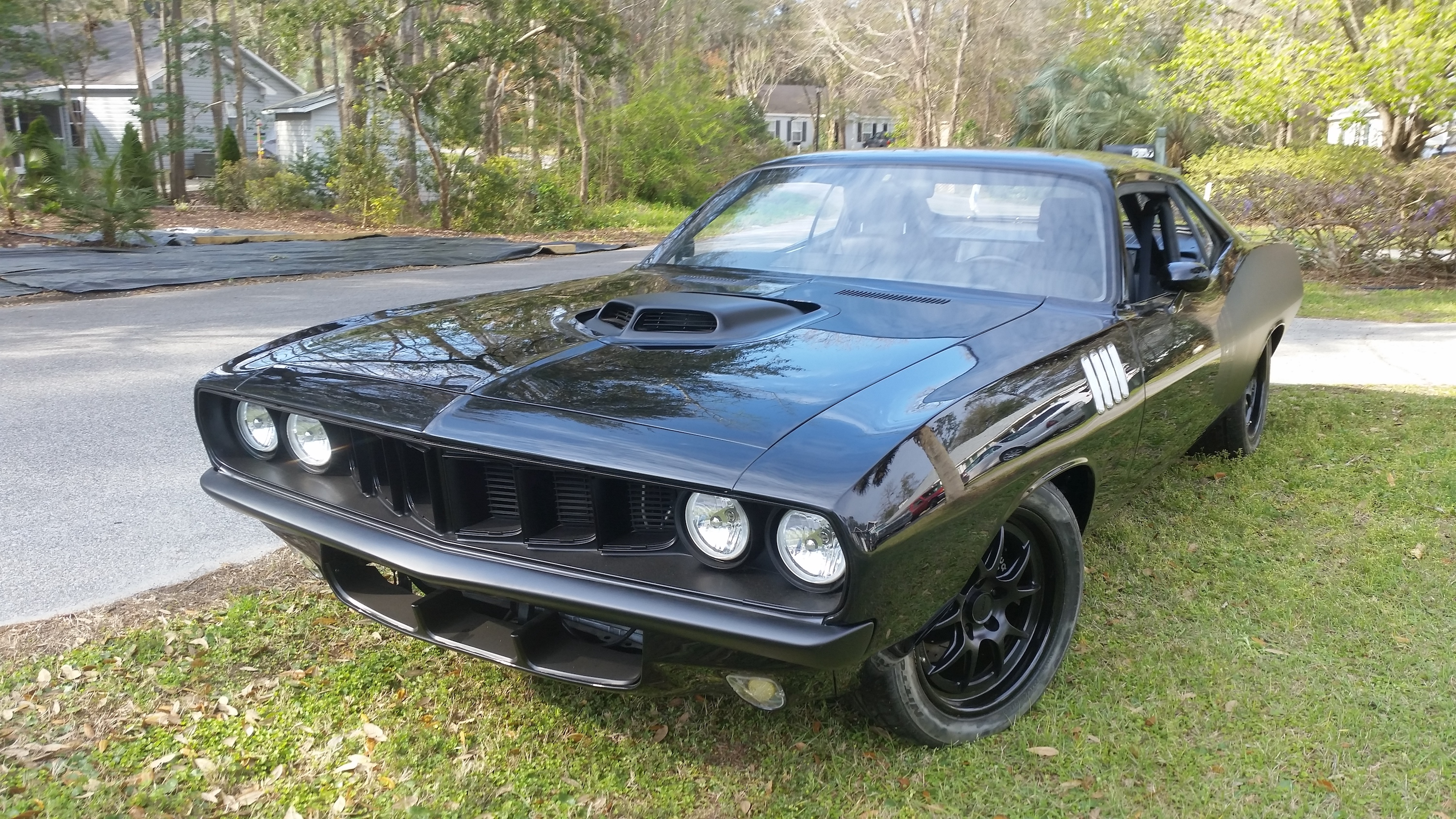 a black 1971 plymouth barracuda