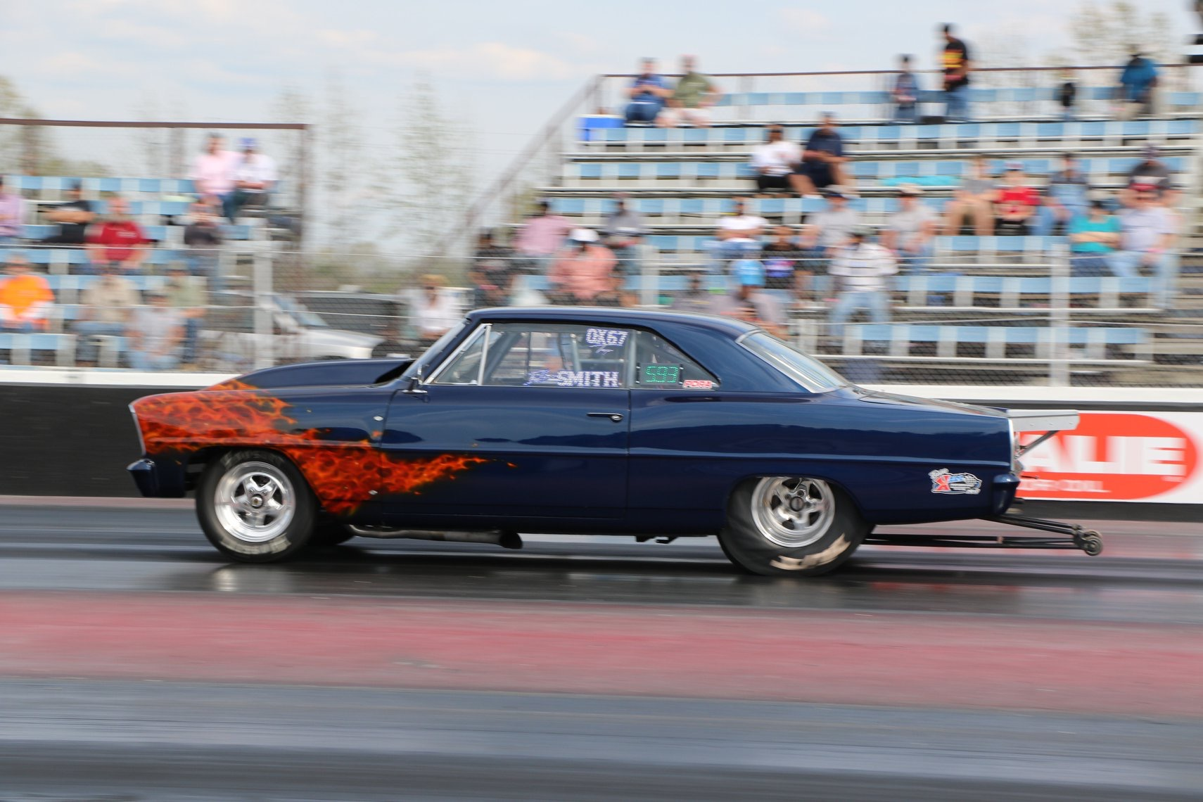 blue 1967 chevy ii with flame