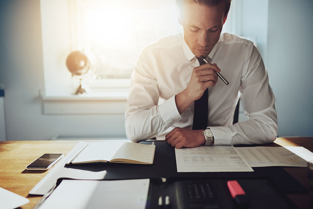 An employee looking at reports