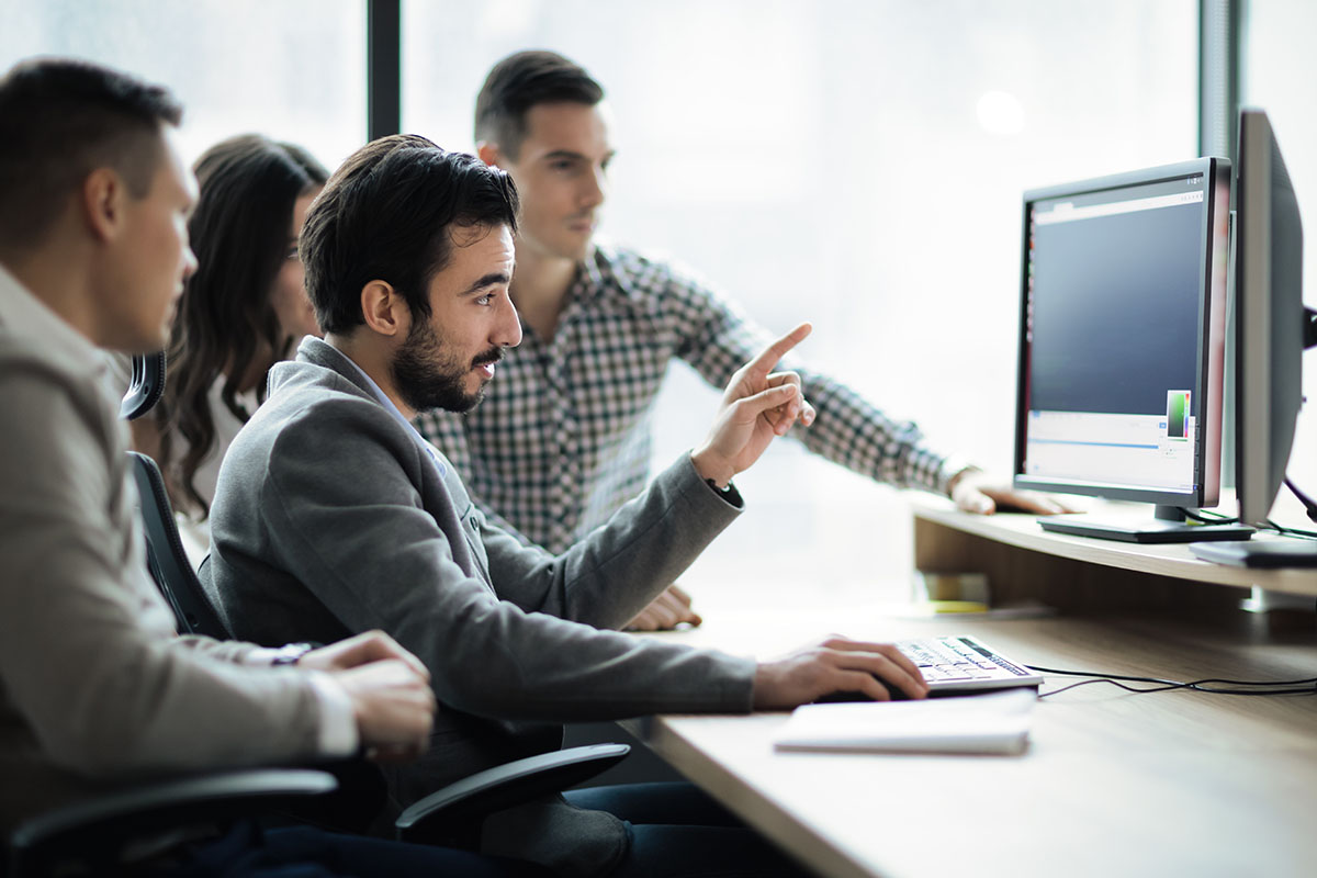 Software employees looking at a computer