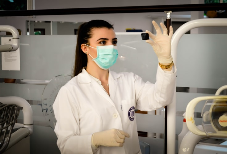 woman looking at something in a labn