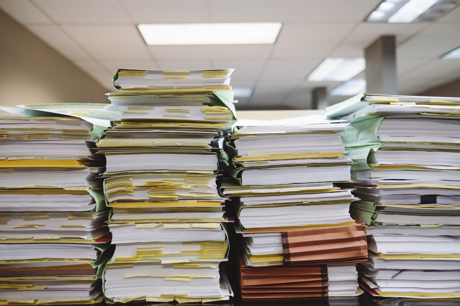 A large stack of paperwork